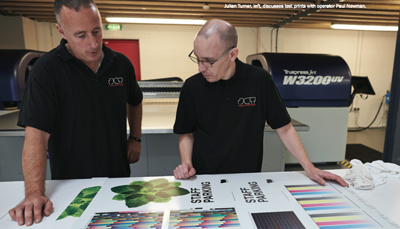 Julian turner, left, discusses test prints with operator Paul Newman